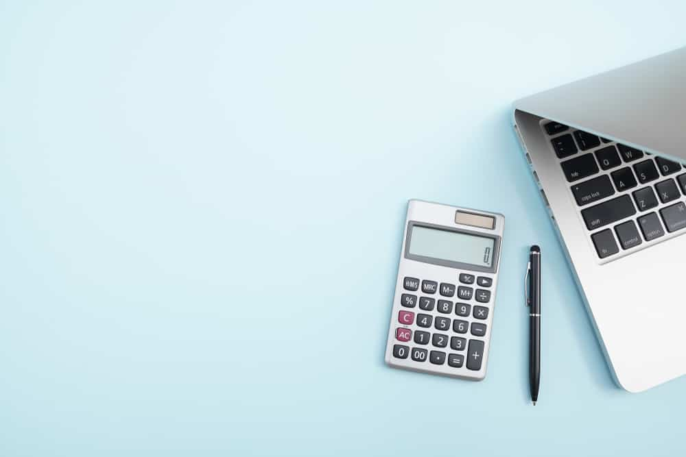how bloggers make money every month laptop calculator desk