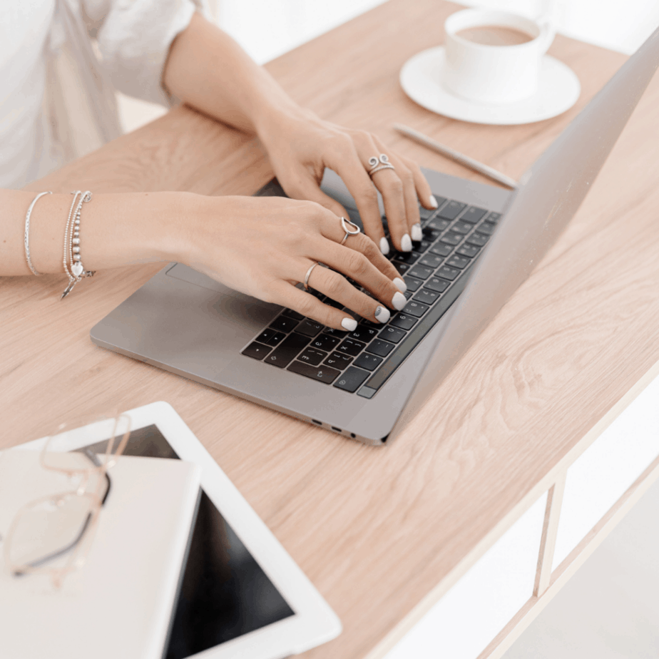 woman working from home laptop coffee